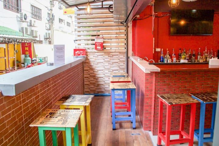 The hostel common area has a bar at the front of the building. It is open to the elements, so we allow smoking in this front area. Guests can enjoy cheap drinks and good company while playing games with other hotel guests.