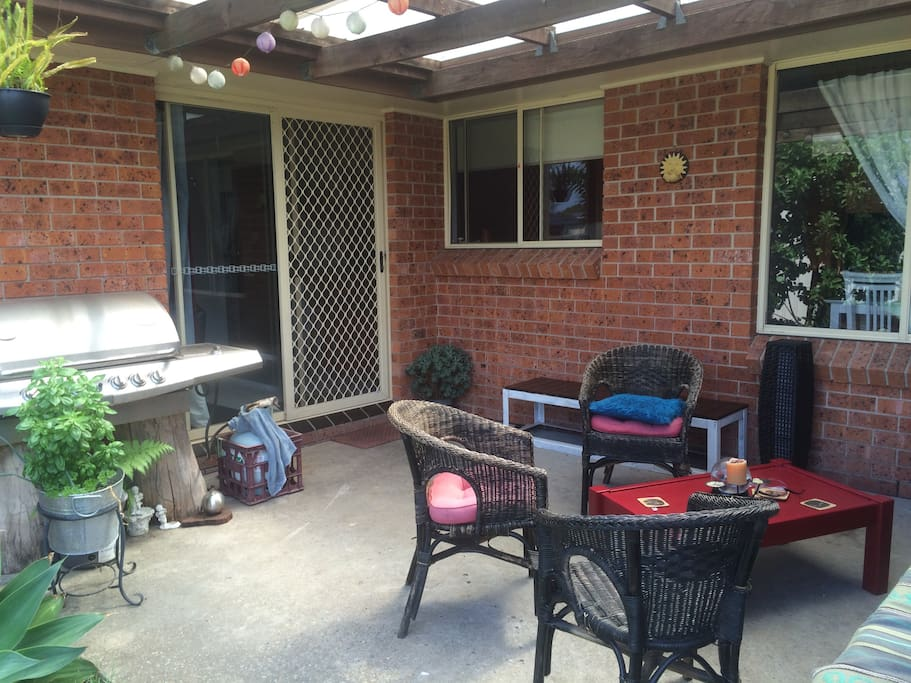 Outdoor covered patio with BBQ facilities.