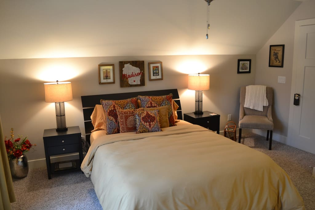 Private guest bedroom has a comfy queen bed with a feather duvet comforter, lots of light, and plenty of room for your belongings