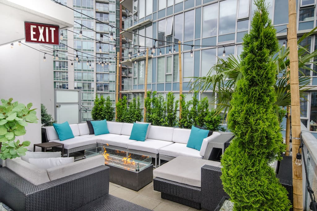 Our private rooftop patio complete with soft seating and outdoor fire table to watch the sun set and enjoy a glass of wine.