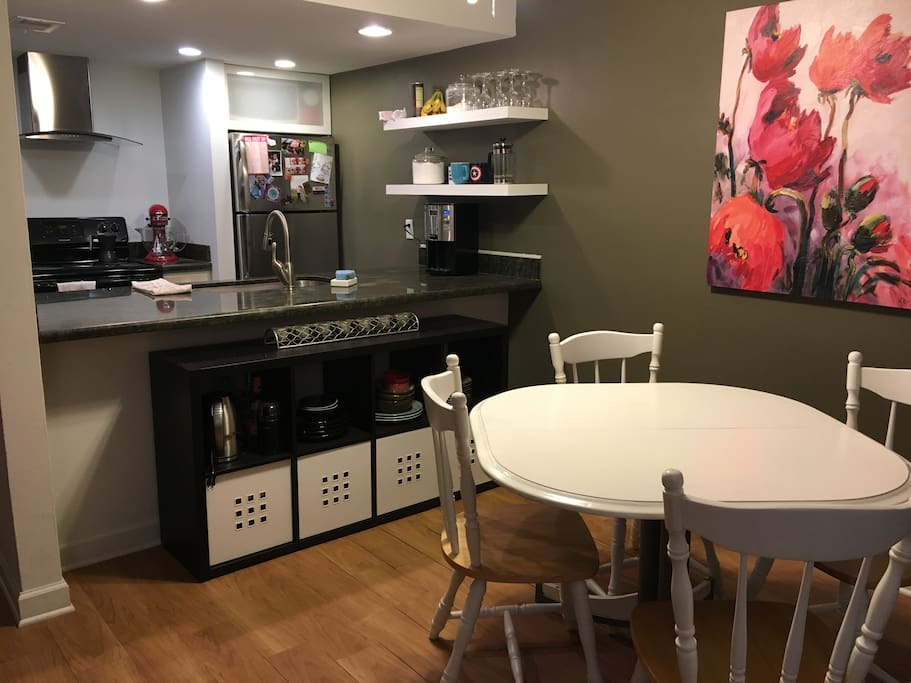 Kitchen supplies and bar area to dining space