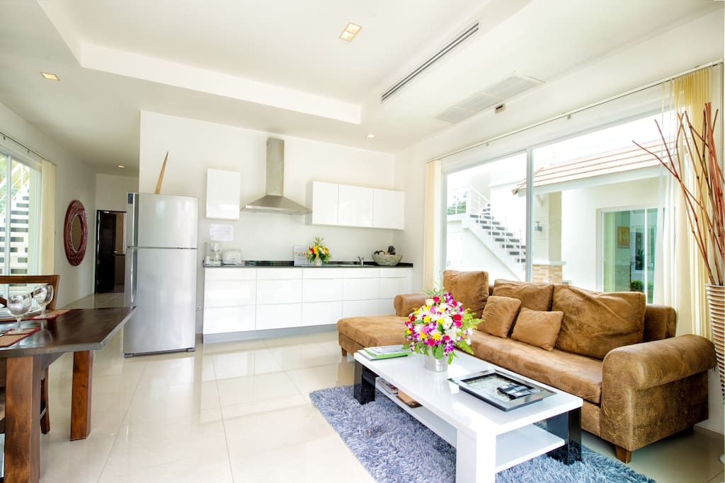 Living-room with, dining table and kitchen.