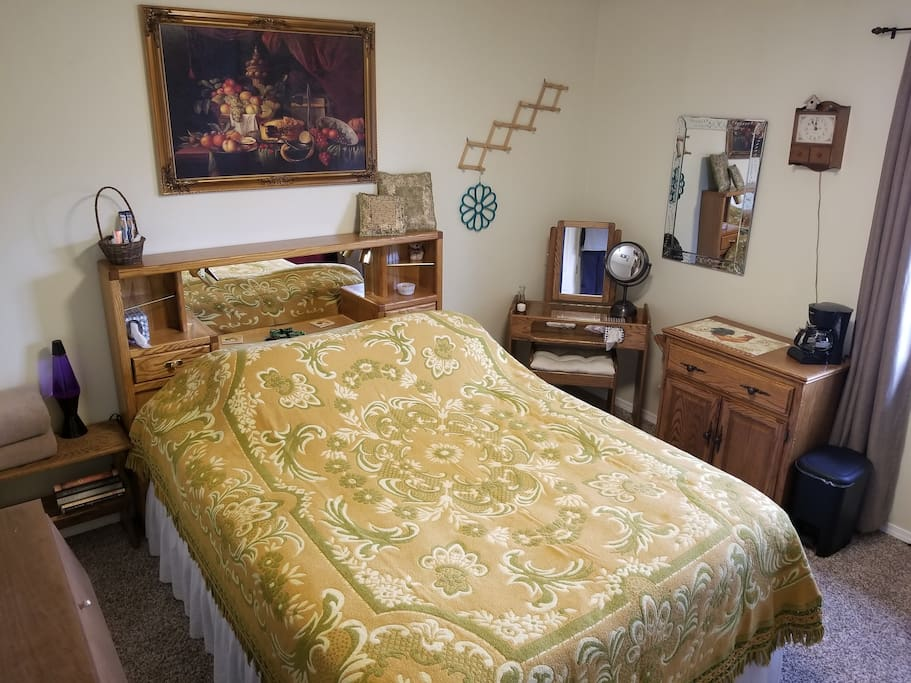Your accommodations!  A comfortable queen bed and many room ammenities await you.
