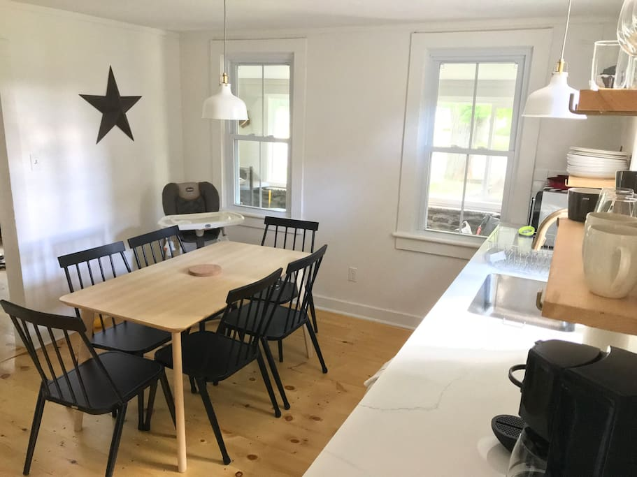 Kitchen with dining table and high chair available
