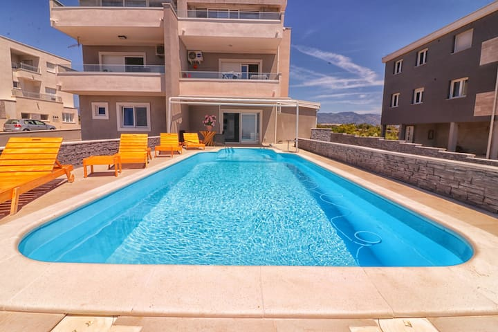 Luxury apartment with private pool and garage.