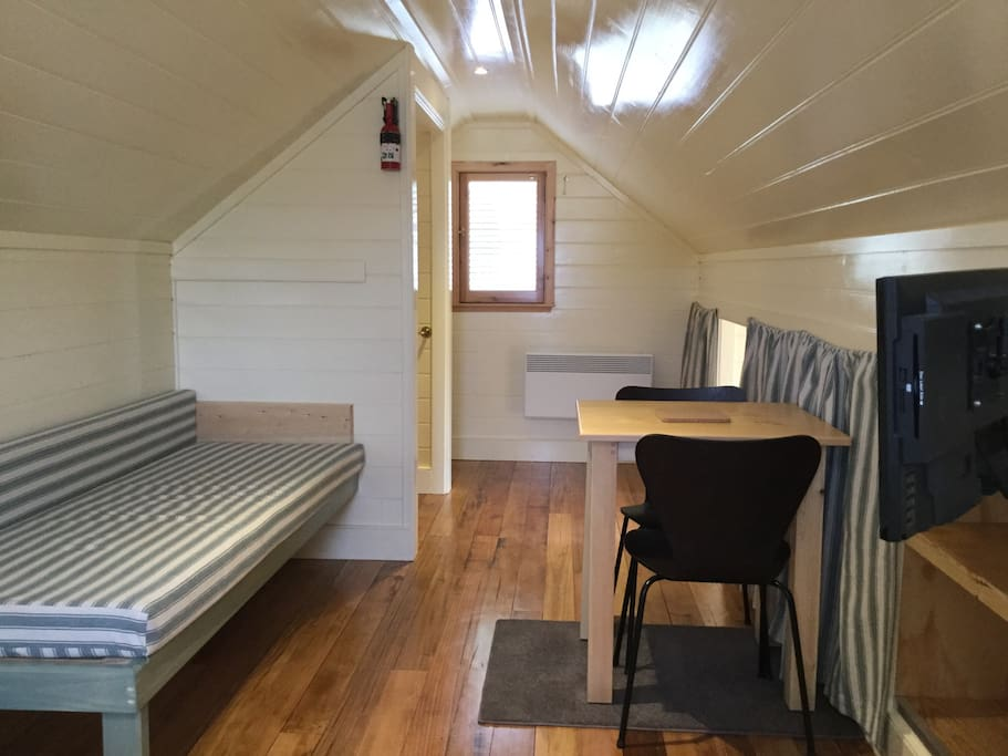 Spare caravan bed size bed. Linen available on request. Table and chairs