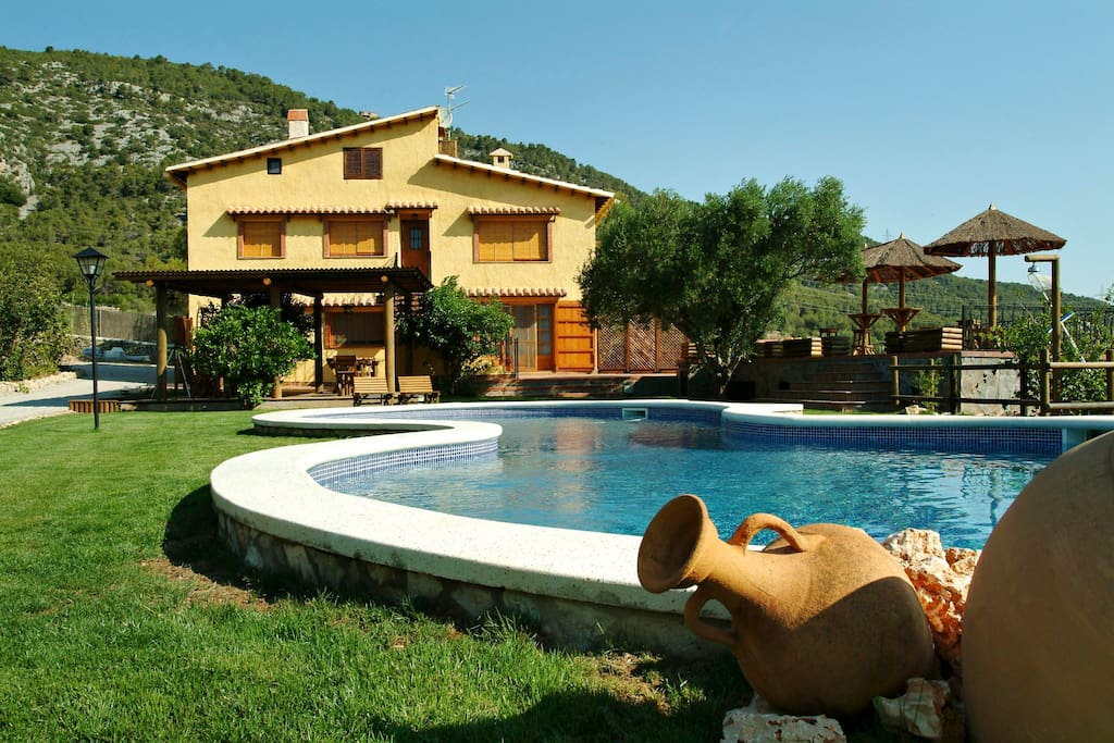 Pool with garden, olive groves, fruit trees.