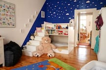 Spacious childrens room with bunk bed.
