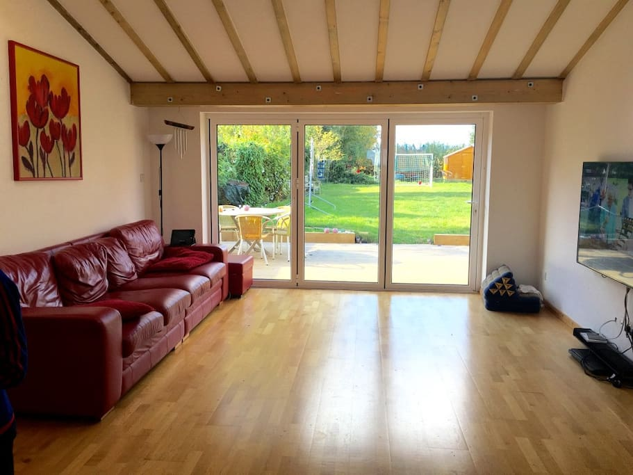 Main lounge. 65inch tv.  Bifold doors to garden
