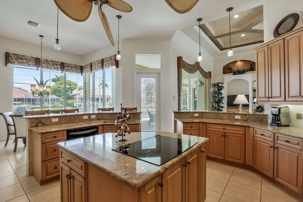 Gorgeous fully equipped kitchen with breakfast bar and an island.