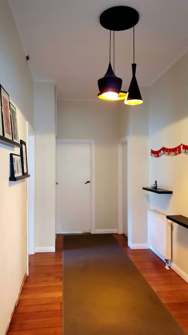 Wide entrance hall joins together the living areas.