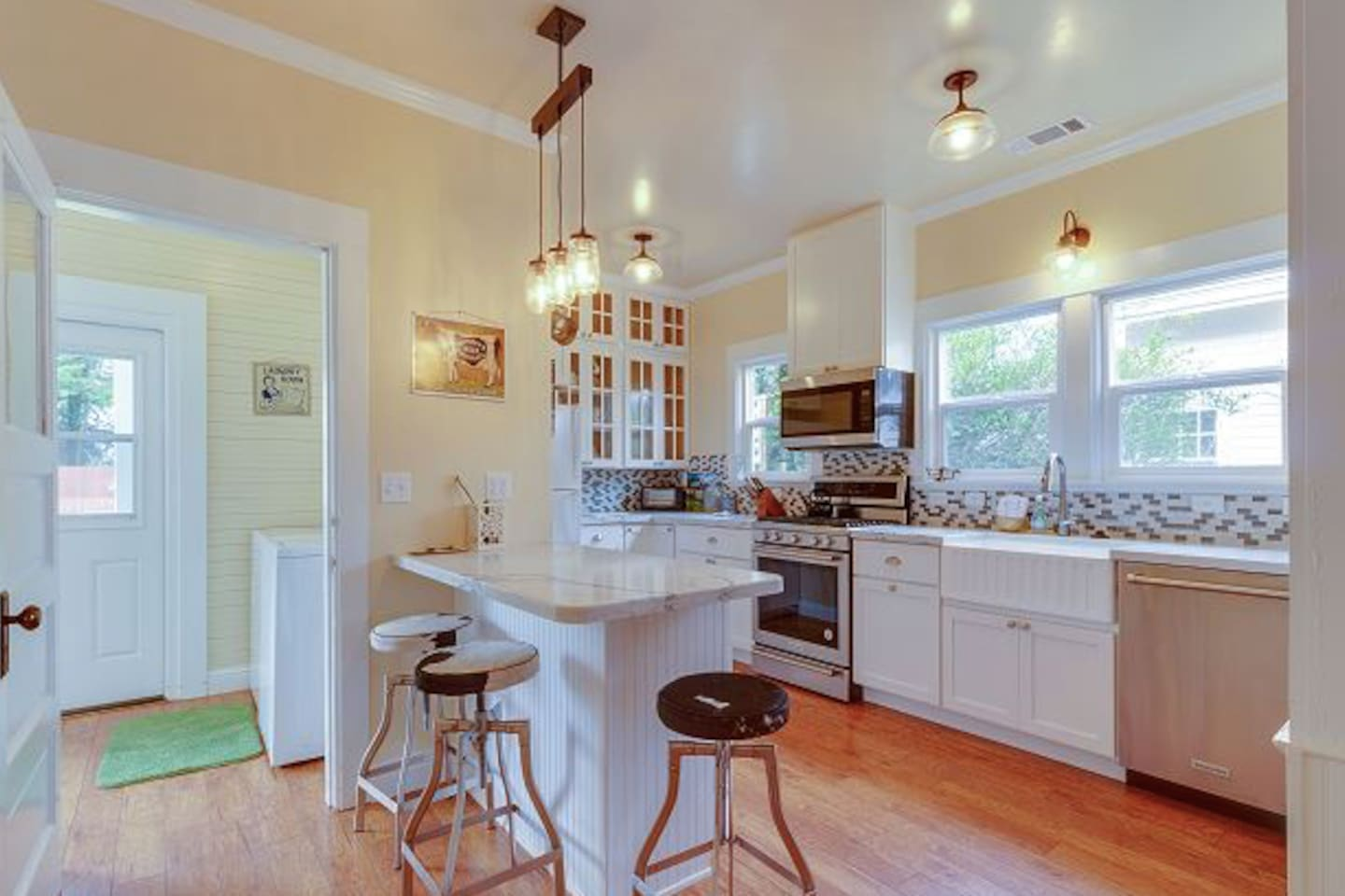 Sunny and warm remodeled kitchen with all the goods to cook meals with the ones you love!