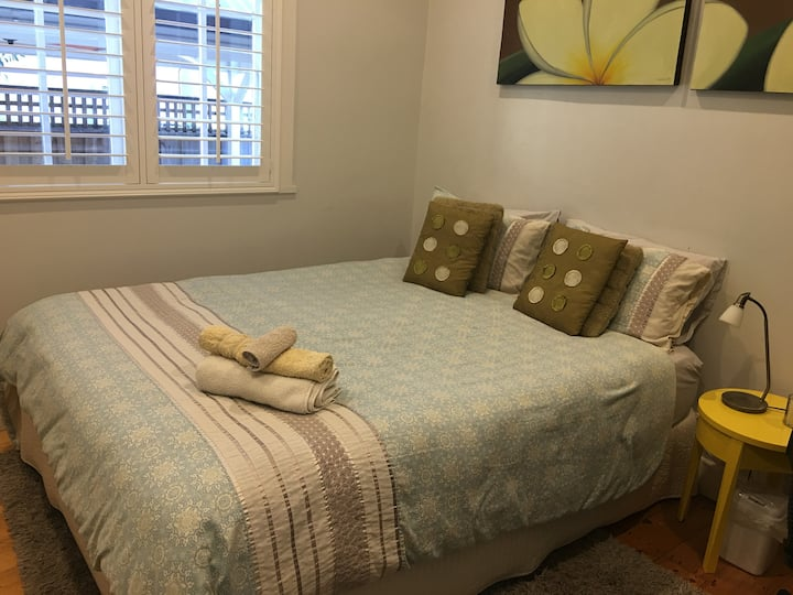 Queen size bedroom in family home.