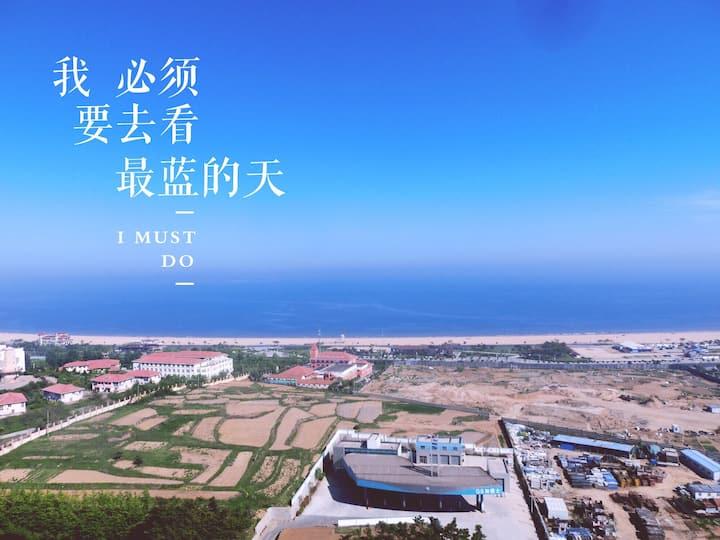青岛金沙滩 明信片公寓,独享无敌海景双卧,可以吹着海风涮火锅 的海边清新小屋