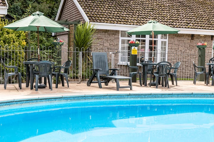 Set overlooking the heated swimming pool.