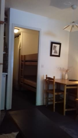 Bunked beds in the entrance (view from the main room). There's a door between the main room and the bunked beds.