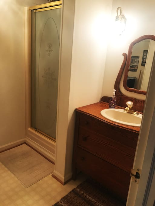 On Suite Bath with Antique Dresser converted into the Vanity