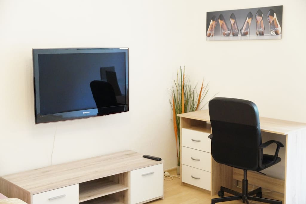 Full HD TV with Apple TV, Desk to get Business Done