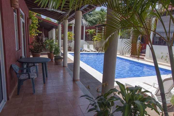 Private patio off the living and master bedroom overlooking the pristine shared pool. Perfect for relaxing with an afternoon beverage and a dip in the pool to cool off.