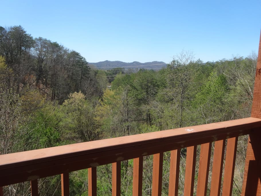 View from porch of valley below and mountains in the distance - spring view