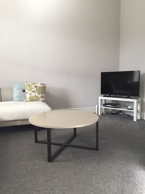 Relaxing lounge area with flat screen TV and high speed wifi.