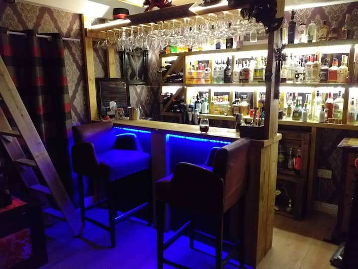 Beautiful flat that comes with its own bar.