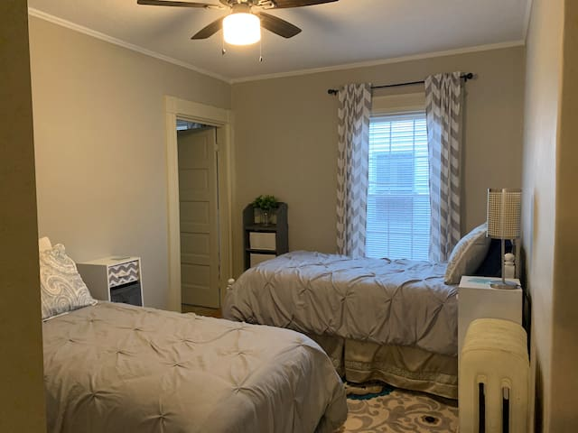 3rd bedroom with 2 twin beds, closet and ceiling fan. Please note this room does not have an A/C unit or TV.
