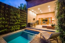 private pool with jacuzzi and sun bath area