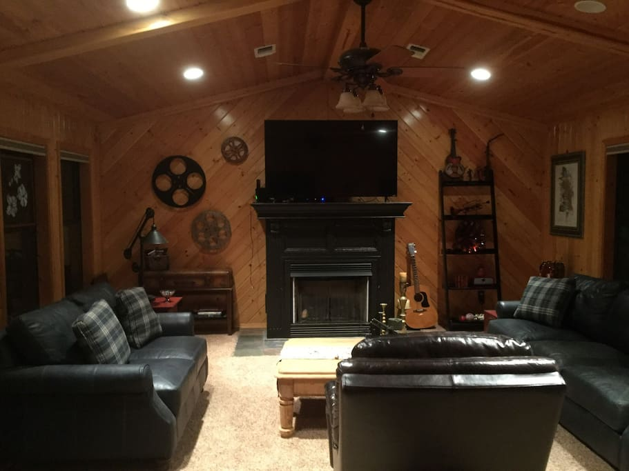 Common area living room, 65 in screen, log fireplace. Guest use only