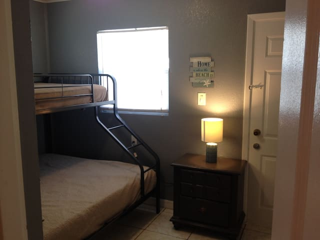 Second bedroom with a queen/twin bunk. A pack n' play is also stored in the closet for those needing one.