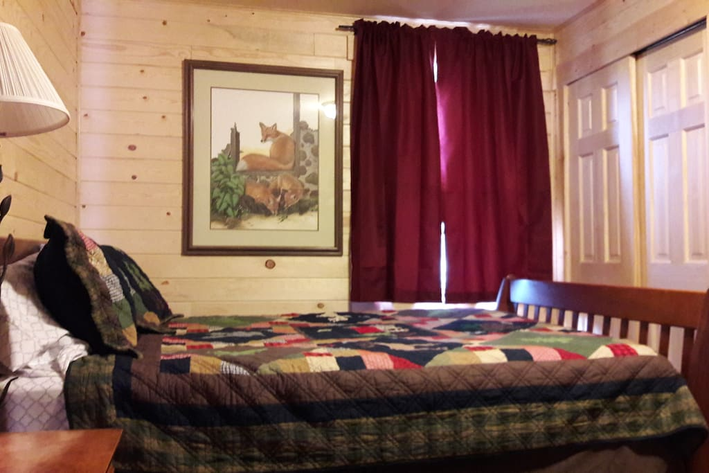 Bedroom with queen bed and twin bunkbed.