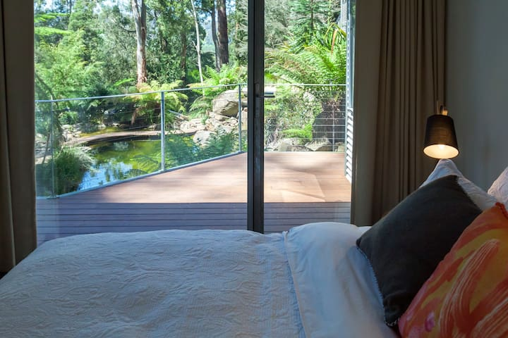 Bedroom 2, views to natural pool