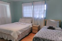3rd Bedroom with queen and twin beds.