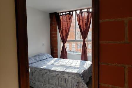 Cálida habitación cercana a Aeropuerto-Zona Franca