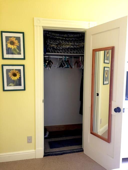 Spacious closet with full length mirror