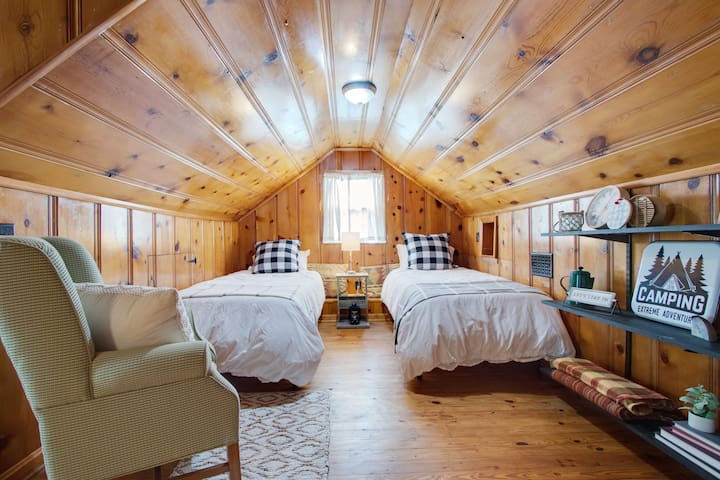 2 twins in the rustic attic space.