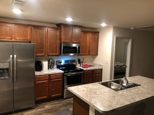 Fully equipped kitchen what stainless steel appliances to prepare delicious foods.