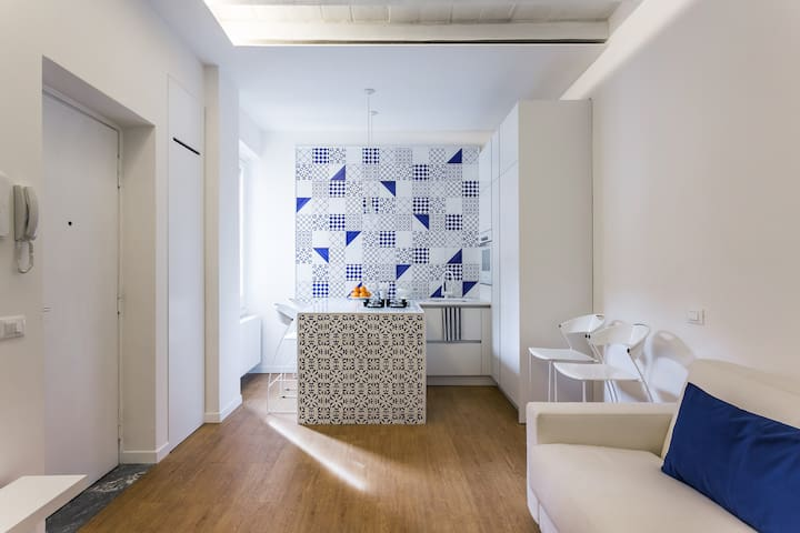 The kitchen is decorated with traditional hand made tiles
