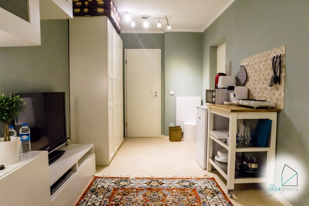 The studio apartment welcomes you with a cozy and bright interior.