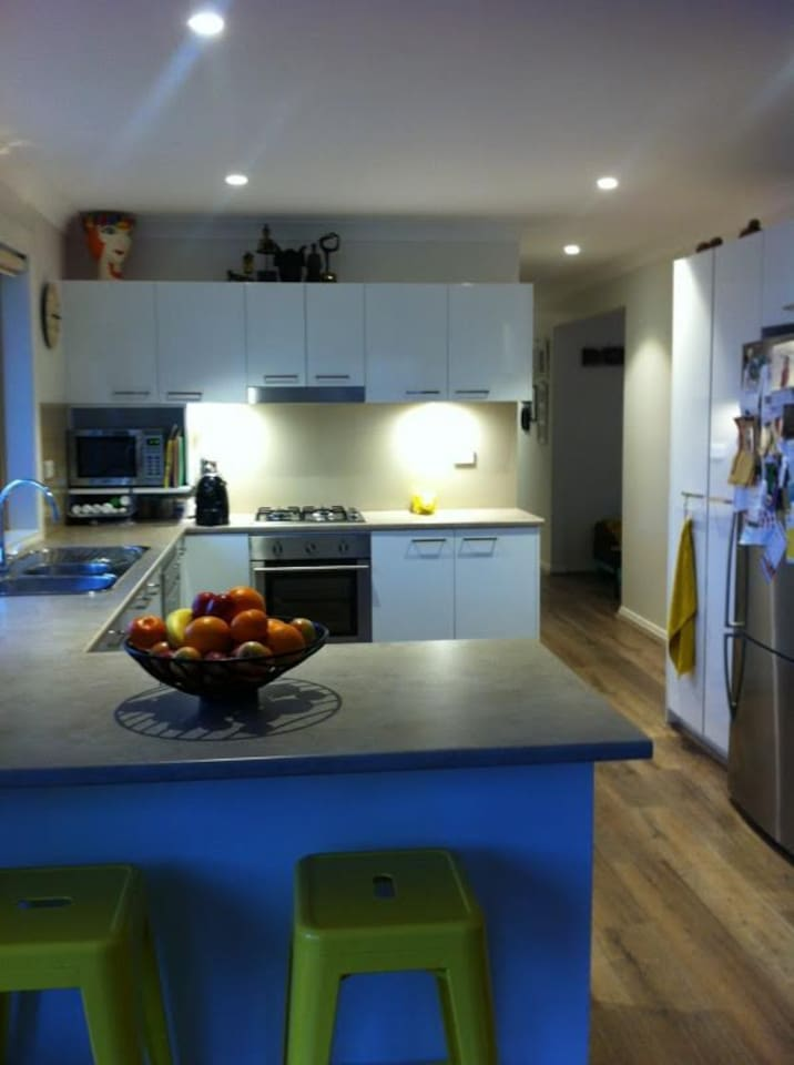 Kitchen with dining and easy area and separate TV lounge area and sit down bench to garden