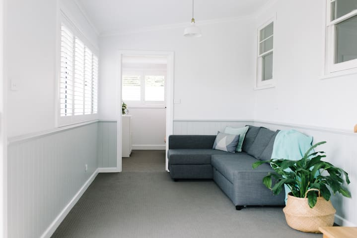 Sunroom with sofa-bed which converts to a double bed.