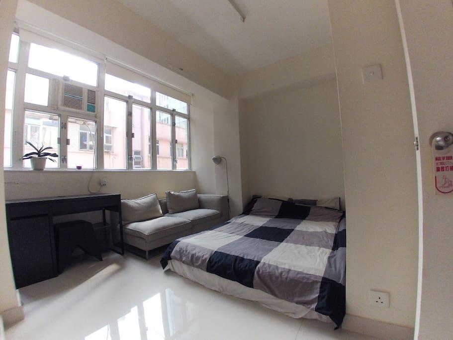 Bedroom with huge windows + small desk