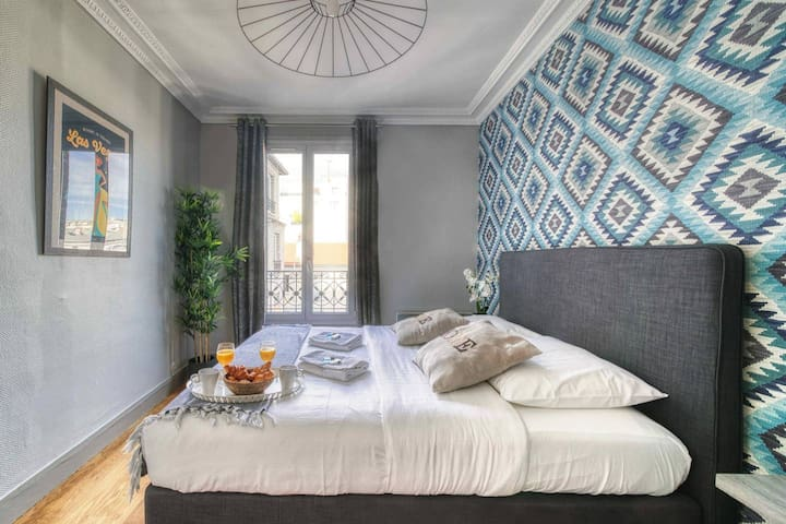 Sunny bedroom with a wide bed