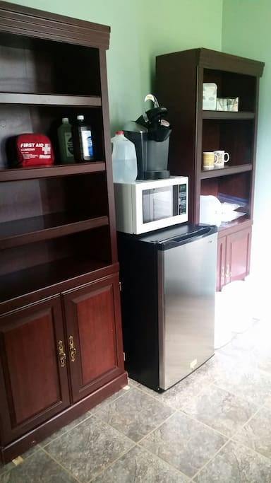The kitchenette has a Keurig coffee maker, mugs (complimentary coffee, coconut sugar & stevia sweetener), bottled water, disposable paper and plastic ware as well as a mini fridge & microwave.