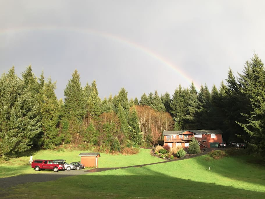 Our home at the end of the rainbow, tucked into the woods