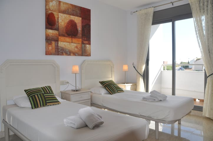 Second Bedroom with A/C and terrace overlooking the pools