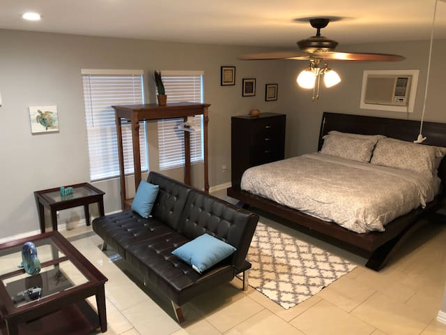 Sitting area and king size bed. Ice cold air conditioning along with storage for clothing.