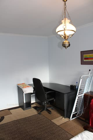 Main bedroom with working desk