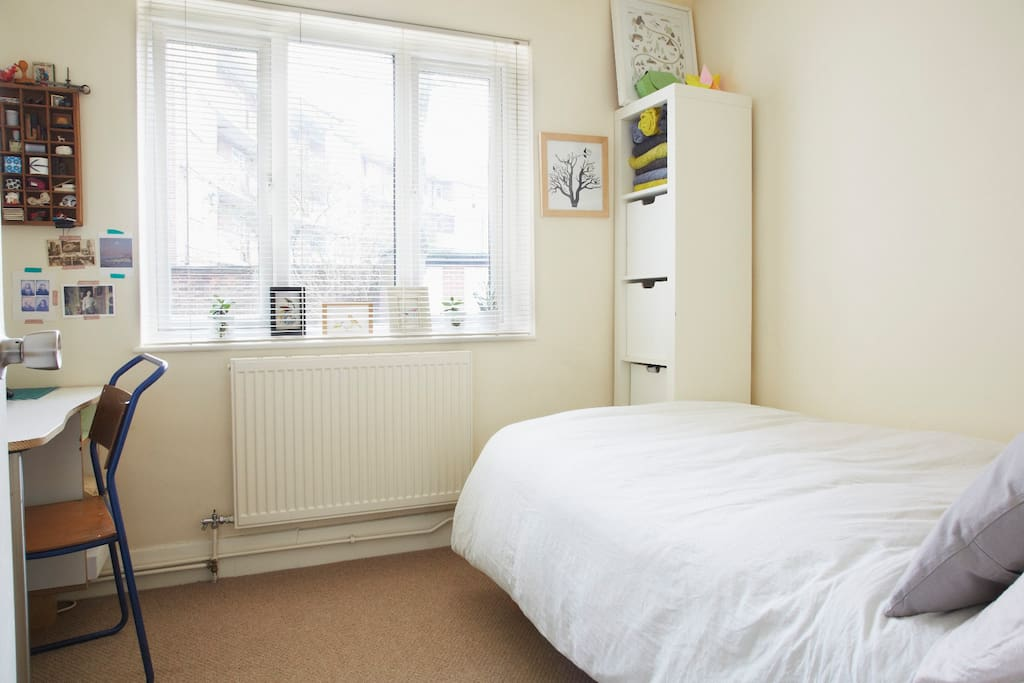 3/4 sized double bed in very quiet Guest bedroom  looking out onto a private shared back garden.