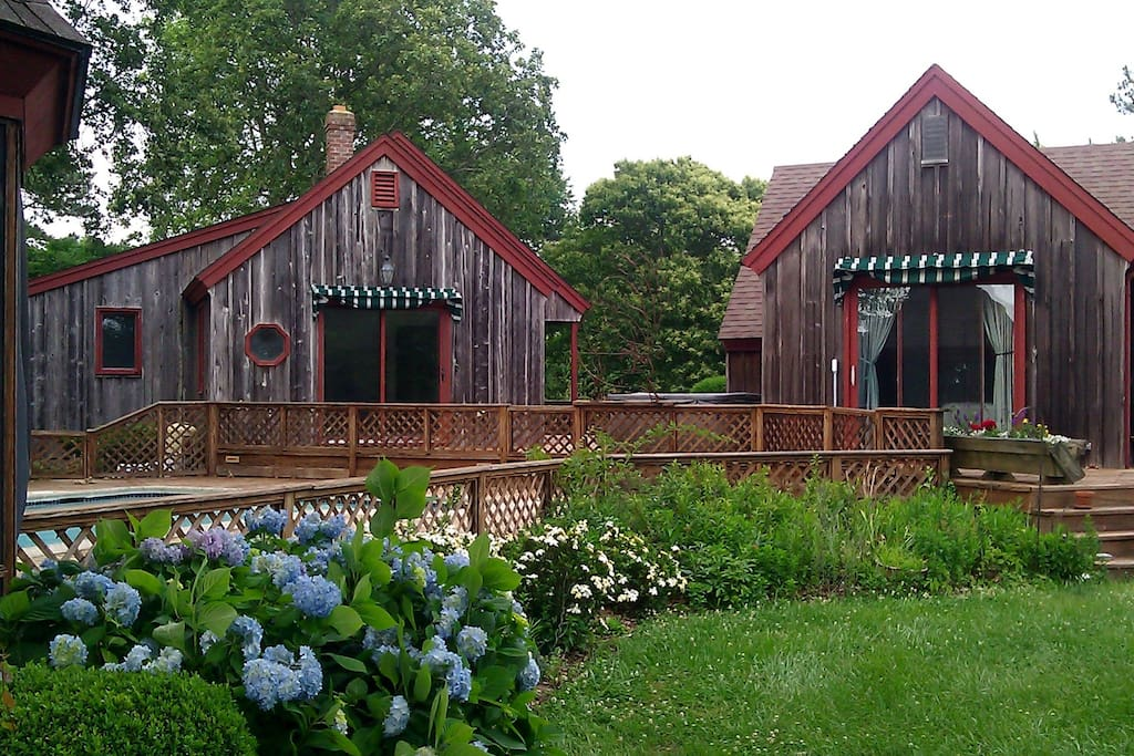 View of the main house and the guest cottage from the pool gazebo.